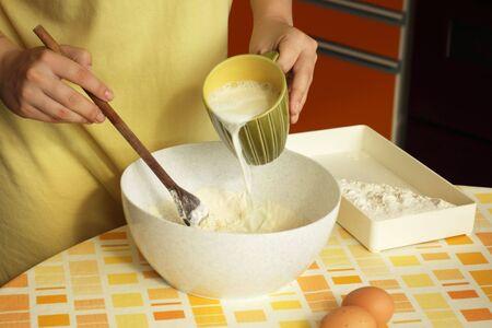 Woman preparing dough for pancakes Stock Photo - 7417102