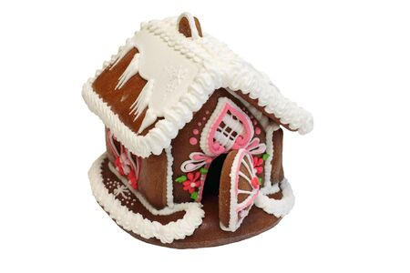 Isolated  gingerbread house with focus on front door photo