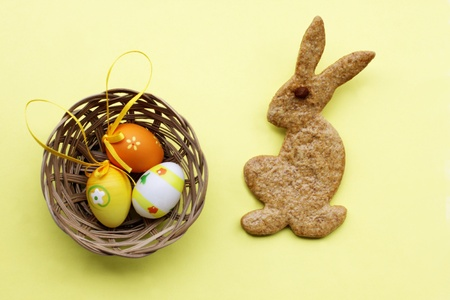 Easter bunny from gingerbread with eggs photo