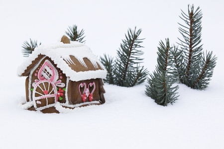 Christmas gingerbread house on the  snow   photo