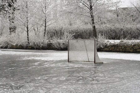 Ice ring and hockey net, old photo