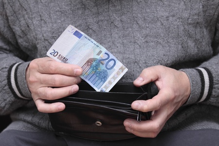 Pensioner showing the last Euro in his wallet