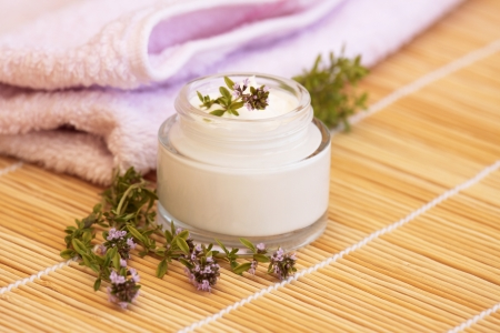 Cosmetic cream and thyme Stock Photo