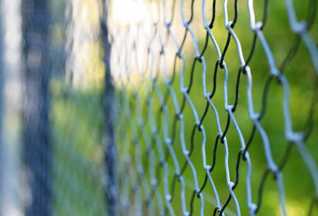 Chain link fence, blurred in a shallow depth of field photo