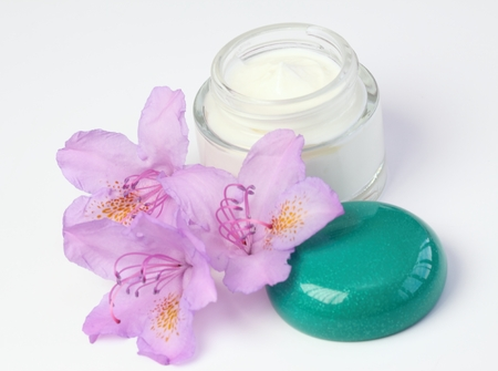 Face and body cream with flower rhododendron photo