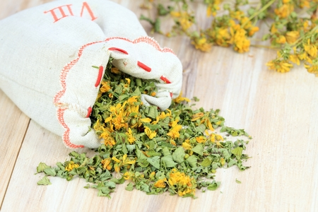 curative: Bag full of curative herb, lat. Hypericum perforatum