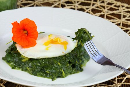 water cress: Spinach,  poached egg and edible flower of water cress