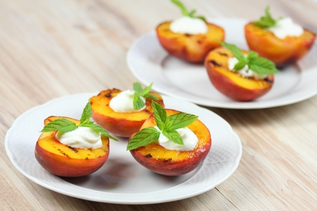 Grilled peaches and mascarpone with mint  leaves