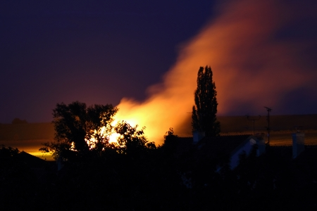 burning bush: Stack of hay in fire near the village Stock Photo