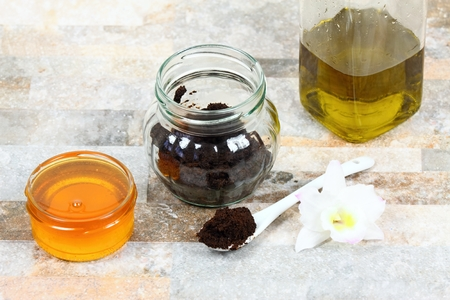 Skin scrub  from used  coffee grounds, honey and olive oil. Good for face acne and body cellulite Stock Photo