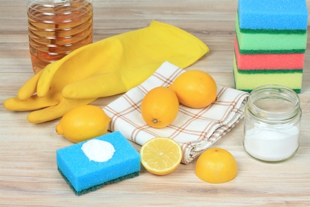 Eco friendly natural cleaners. Home cleaning concept. Baking soda (sodium bicarbonate), lemon, vinergar and salt