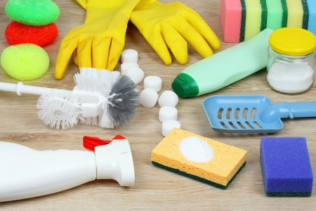 House cleaning products on wooden table. Salt pelets, baking soda (sodium bicarbonate), detergent, spray