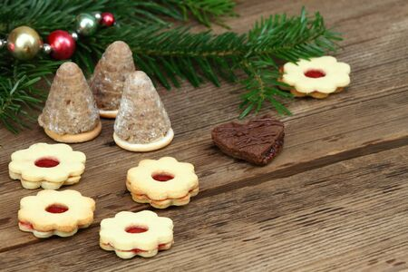 Christmas cookies made at home. Various xmas shortbread cookies on the brown wooden table. Typical for central Europe.