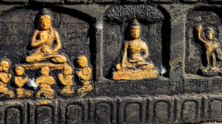 Stone carving of Buddha teaching monks, getting enlightenment under Bodhi tree Stok Fotoğraf