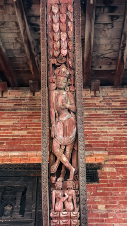 Wood carvings of Hindu Gods on the temple in Bhaktapur Durbar Square