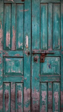 Closed old wooden door with open lock. Vintage