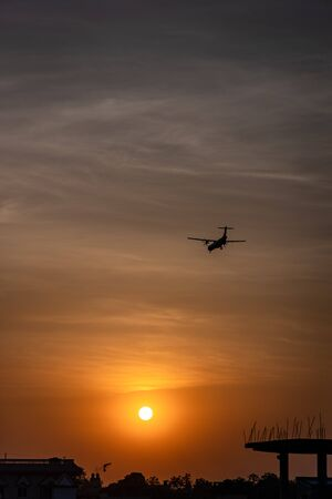 Silhouette of an airplane during take off or landing