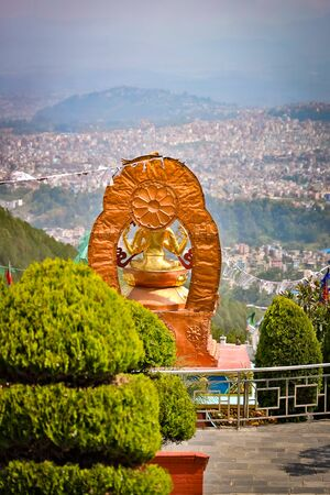 Statue of Buddha looking over houses in Kathmandu, Nepal Stok Fotoğraf