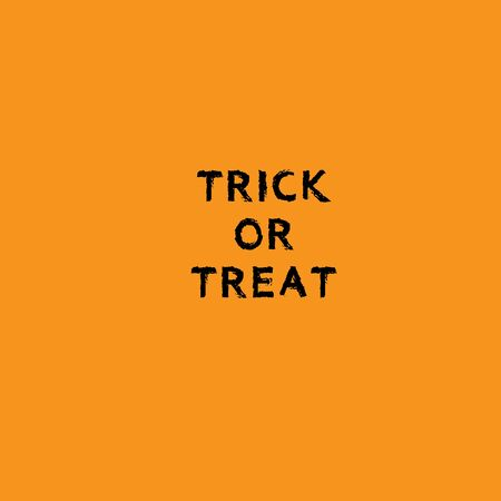 Trick or Treat text isolated on orange background. Calligraphy vector illustration Archivio Fotografico - 130779779