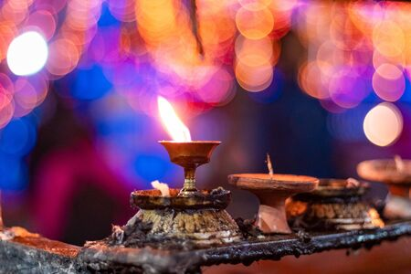 Diwali candle diya or butter lamps with bokeh