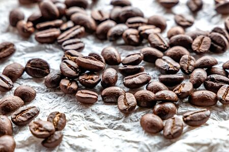 Roasted coffee beans on white background Reklamní fotografie