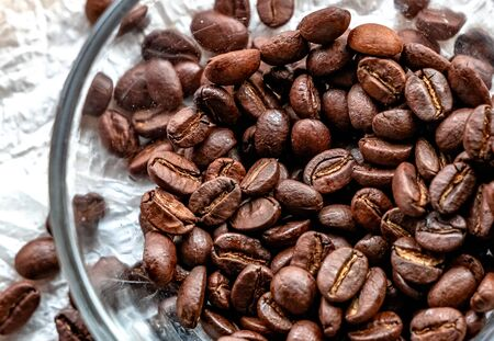Roasted coffee beans on white background Archivio Fotografico - 132044022