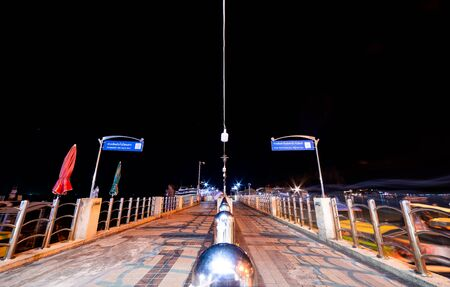 Phi Phi Island, Thailand - November 24 2019: Deserted Ao Tonsai Pier at night. This pier is the main entry and exit point for all the tourists visiting Phi Phi Islands.