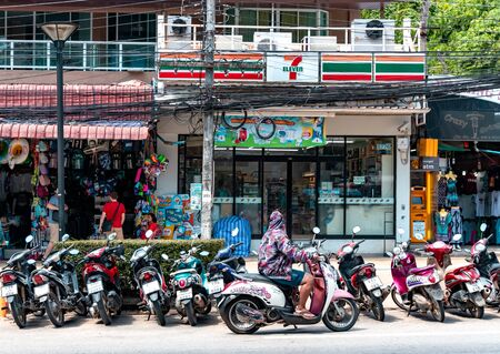 Krabi Town, Thailand - November 24 2019: Bike and scooters parked on the side of the road. Local use scooters as main mode of transportation around the town.