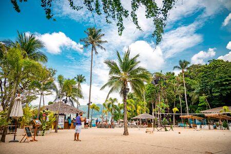 Phuket, Thailand - November 27 2019: Paradise Beach in Phuket, Thailand. Famous tourist attraction. Tropical Beach. Perfect summer getaway.
