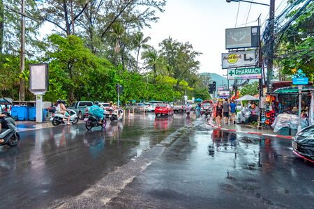 Patong, Thailand - November 27 2019: Vehicles moving about at Patong beach area after rain. Редакционное