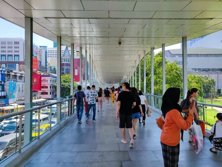 Bangkok, Thailand - November 29 2019: Crowd of pedestrian bustling away on a busy day on the Ratchaprasong District R Walk elevated pedestrian walkway.
