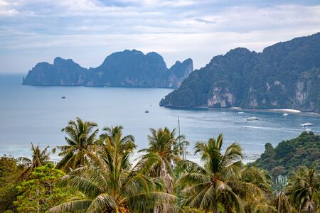 Speedboats and traditionals boats sailing in Andaman Sea as seen from viewpoint in Phi Phi Islands in Thailand.