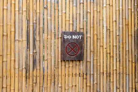 Bamboo background pattern. Do Not enter written on a wooden board. Stock Photo