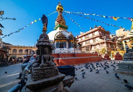 Kathmandu, Nepal - December 22 2019: Buddhist shrine surrounded by local houses in the narrow alley of Kathmandu city.