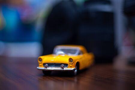 Miniature of a yellow car. extreme closeup. Фото со стока