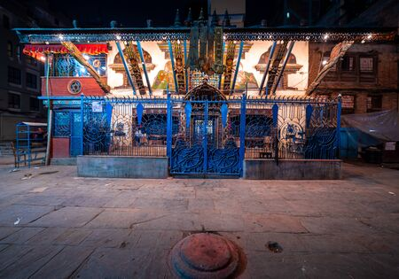 Hindu Temple decorated with lights at night time