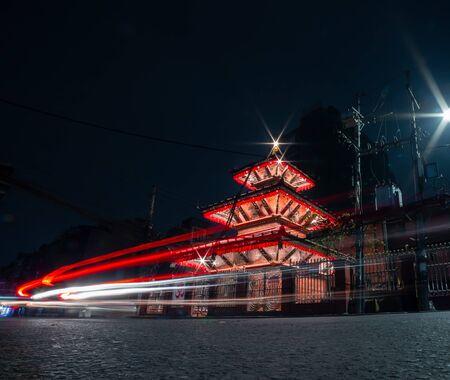 Long exposure of a well illuminated Hindu Temple at night Фото со стока