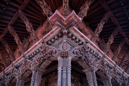 Detailed wood carvings of Hindu Gods and sculptures on ancient temples of Nepal.
