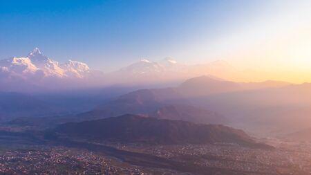 Himalaya Range During Sunrise. First Rays Of Sun Hitting The Himalayas