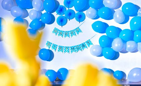 Happy birthday party background. Wall decorated with colorful balloonns and Happy Birthday sticker hanging on the wall. Reklamní fotografie
