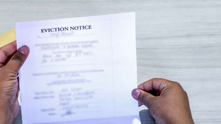 Hands of a man holds eviction notice letter
