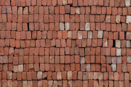 Brick Pattern. Stack of fresh processed bricks loosely stacked horizontally.