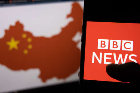 Kathmandu, Nepal - February 12 2021: BBC News Logo against the Map of China in red on a computer screen in the background. Publikacyjne
