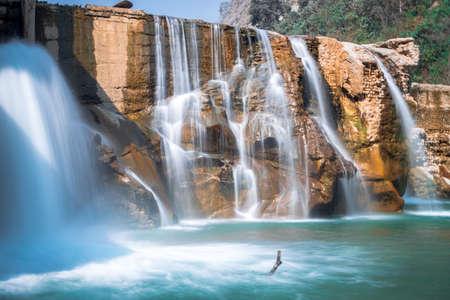 Smooth Long Exposure of Waterfall. Creamy Beautiful waterfall falling off a cliff in the mountas. Zdjęcie Seryjne