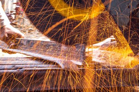 closeup of circular grinder cutting iron