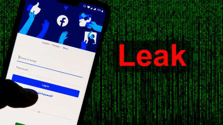Kathmandu, Nepal - April 4 2021: Facebook App aginst Leak text in red and Matrix-style green background. 533 Million Facebook User's personal information has been leaked online on Saturday, April 4th 2021.