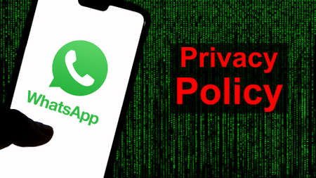 Kathmandu, Nepal - April 14 2021: WhatsApp Privacy Policy Controversy. Privacy policy in red against the WhatsApp logo and green text background.