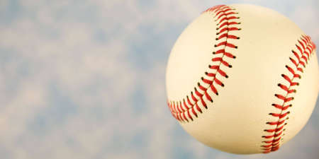 A close up of a baseball with a blue sky. Stock Photo - 5206945