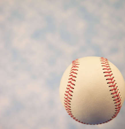 A close up of a baseball with a blue sky. Stock Photo - 5206942
