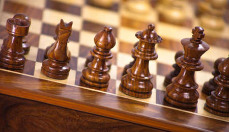 A close up of a wood chess board.